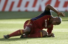 Kim Raff | The Salt Lake Tribune Real Salt Lake player Jamison Olave reacts to missing a shot on goal during a corner kick against the Portland Timbers at Rio Tinto Stadium in Sandy, Utah on July 7, 2012.