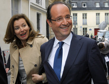 FILE - French Socialist Party candidate for the upcoming French presidential election Francois Hollande and his companion French journalist Valerie Trierweiler, left, in Paris in this file photo dated Thursday, April 5, 2012.  According to reports on Friday July 13, 2012, Hollande is widely expected to break his silence about