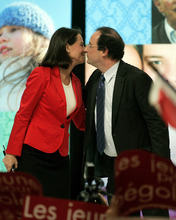 FILE - Socialist French presidential candidate Segolene Royal, left, kisses her partner Secretary-General of the Socialist Party Francois Hollande during a meeting in Limoges, central France, in this file photo dated Thursday March 29, 2007.  According to reports on Friday July 13, 2012, French President Fancois Hollande is widely expected to break his silence about