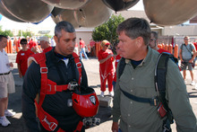 Gas station owner Kent Couch, right, confers with Iraqi adventurer Fareed Lafta  before taking off from Bend, Ore., in tandem lawn chairs suspended from helium-filled party balloons, Saturday, July 14, 2012 in Bend, Ore.. The two men hoped to fly across Oregon, Idaho and into Montana. (AP Photo/Jeff Barnard)