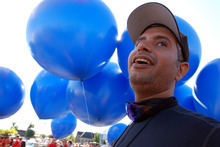 Iraqi adventurer Fareed Lafta watches with delight as party balloons are flated with helium to carry him aloft in a tandem lawn chair rig with gas station owner Kent Couch, Saturday, July 14, 2012 in Bend, Ore.. The two men hoped to fly across Oregon, Idaho and into Montana. (AP Photo/Jeff Barnard)