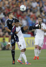 San Jose Earthquakes' Victor Bernardez, left, and Real Salt Lake's Javier Morales vie for the ball during the first half of an MLS soccer game in Santa Clara, Calif., Saturday, July 14, 2012. (AP Photo/Jeff Chiu)