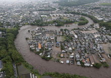 In this July 12, 2012 photo, residential streets are submerged after a river overflowed its banks in Kumamoto, Kumamoto prefecture on Japan's southern island of Kyushu. Heavy rains hit southern Japan, triggering flashfloods, mudslides and destroying dozens of homes. (AP Photo/Yomiuri Shimbun, Masanobu Nakatsukasa) JAPAN OUT, CREDIT MANDATORY
