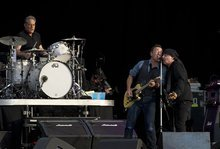 Bruce Springsteen and Stevie Van Zandt , right, perform at the Hard Rock Calling Festival in London's Hyde Park, Saturday, July 14, 2012. (AP Photo)