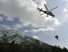 Jim Urquhart | Tribune file photo Search-and-rescue workers are airlifted by helicopter in April 2009 to Mount Olympus to assist in a rescue operation. A woman hiker fell 1,000 feet to her death into a snow-filled ravine on Mount Olympus. Her son and another 14-year-old boy survived.