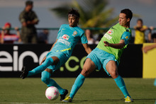 Brazil's Neymar, left, fights for the ball with Leandro Damiao during a training session in preparation for the London 2012 Olympics in Rio de Janeiro, Brazil, Wednesday July  11, 2012. (AP Photo/Felipe Dana)