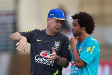 Brazil's soccer coach Mano Menezes, left, gives directions to Brazil's player Marcelo during a training session in preparation for the London 2012 Olympics in Rio de Janeiro, Brazil, Wednesday July  11, 2012. (AP Photo/Felipe Dana)