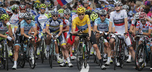 The pack with Bradley Wiggins of Britain, wearing the overall leader's yellow jersey, Tejay van Garderen of the US, wearing the best young rider's white jersey, and Fredrik Kessiakoff of Sweden, wearing the best climber's dotted jersey, waits for the start of the 14th stage of the Tour de France cycling race over 191 kilometers (118.7 miles) with start in Limoux and finish in Foix, France, Sunday July 15, 2012. (AP Photo/Christophe Ena)