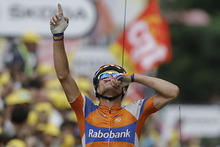Luis-Leon Sanchez of Spain crosses the finish line to win the 14th stage of the Tour de France cycling race over 191 kilometers (118.7 miles) with start in Limoux and finish in Foix, France, Sunday July 15, 2012. (AP Photo/Laurent Cipriani)