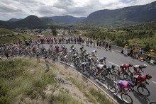 The pack climbs Portel pass during the 14th stage of the Tour de France cycling race over 191 kilometers (118.7 miles) with start in Limoux and finish in Foix, France, Sunday July 15, 2012. (AP Photo/Christophe Ena)