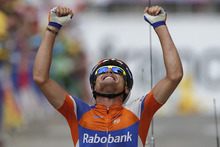 Luis-Leon Sanchez of Spain crosses the finish line to win the 14th stage of the Tour de France cycling race over 191 kilometers (118.7 miles) with start in Limoux and finish in Foix, France, Sunday July 15, 2012. (AP Photo/Laurent Rebours)