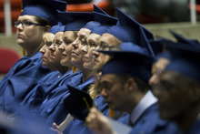 Chris Detrick  |  The Salt Lake Tribune Students listen during Western Governors University's commencement ceremony at the Huntsman Center at the University of Utah Saturday July 14, 2012.