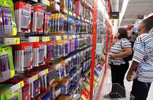 Seth Perlman |  AP file photo Staples kicked off its back-to-school shopping season with crayons, school glue and ballpoint pens for one penny with any $5 purchase,