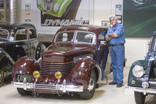 Courtesy photo Jay Leno in his garage with some of his cars.