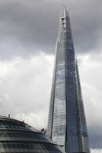 Backdropped by Western Europe's tallest building, the Shard, performers hang from outside City Hall in London as part of the London 2012 Olympic Festival, Sunday, July 15, 2012. (AP Photo/Sang Tan)