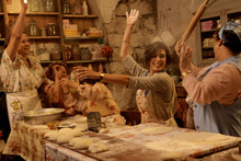 Village women, led by cafe owner Amale (Nadine Labaki, center), sing while baking pastries with a secret ingredient, in the musical comedy-drama