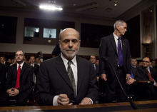 Federal Reserve Board Chairman Ben Bernanke pauses as he arrives to give a  semiannual report to the Senate Banking Committee,  Tuesday, July 17, 2012, on Capitol Hill in Washington. Bernanke's testimony comes as job growth has slumped, manufacturing has weakened and consumers have grown more cautious about spending (AP Photo/Carolyn Kaster)