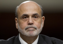 Federal Reserve Board Chairman Ben Bernanke pauses before giving a semiannual report to the Senate Banking Committee,  Tuesday, July 17, 2012, on Capitol Hill in Washington. Bernanke's testimony comes as job growth has slumped, manufacturing has weakened and consumers have grown more cautious about spending (AP Photo/Carolyn Kaster)