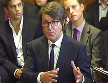 G4S chief executive Nick Buckles, gives evidence on Olympic security staffing to the Home Affairs Select Committee at the House of Commons, London, Monday, July 17, 2012. Buckles, today insisted he was the right person to make sure the firm delivered as many guards as possible despite the Olympics security debacle. (AP Photo/PA) UNITED KINGDOM OUT, NO SALES, NO ARCHIVE
