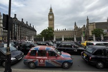 London taxi drivers park their cabs on Parliament Square, outside the houses of Parliament as they take part in a protest in reaction to not being allowed to use the Olympic driving lanes in London, Tuesday, July 17, 2012.  (AP Photo/Matt Dunham)