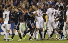 San Jose Earthquakes' Shea Salinas, center left, gets between teammate Sam Cronin (4) and Real Salt Lake's Alvaro Saborio (15) as players confronted each other during the second half of an MLS soccer game in Santa Clara, Calif., Saturday, July 14, 2012. The Earthquakes won 5-0. (AP Photo/Jeff Chiu)