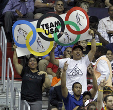 Fans hold an Olympic Rings sign for Team USA during the first half of an Olympic men's exhibition basketball game against Brazil, Monday, July 16, 2012, in Washington. (AP Photo/Alex Brandon)
