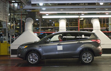 (AP Photo/Brian Bohannon) Ford said it is recalling 2013 Escapes equipped with 1.6-liter four-cylinder engines.