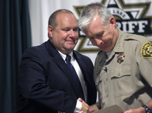 Al Hartmann  |  The Salt Lake Tribune   Unified Police Detective Todd Park, left, shakes hands with Sheriff Jim WInder Wednesday July 18.  Park was recognized for his outstanding work and dedication to solving cold-case homicides.
