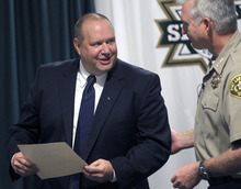 Al Hartmann  |  The Salt Lake Tribune   Unified Police Detective Todd Park, left, accepts certificate from Sheriff Jim WInder Wednesday July 18.  Park was recognized for his outstanding work and dedication to solving cold-case homicides.