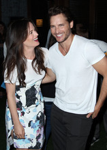 Actress Elizabeth Reaser, left, and actor Peter Facinelli pose together at Summit Entertainment's