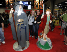 Fans pose with life-sized LEGO Lord of the Rings figures at Comic-Con preview night held at the San Diego Convention Center on Wednesday July 11, 2012, in San Diego.  (Photo by Denis Poroy/Invision/AP)