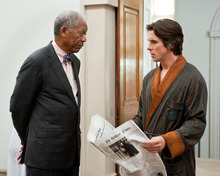 This undated film image released by Warner Bros. Pictures shows Morgan Freeman as Lucius Fox, left, and Christian Bale as Bruce Wayne in a scene from the action thriller