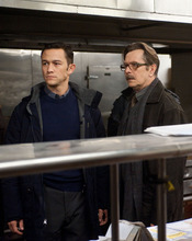 This undated film image released by Warner Bros. Pictures shows Joseph Gordon-Levitt as John Blake, left, and Gary Oldman as Commissioner Gordon  in a scene from the action thriller