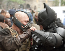 Batman (Christian Bale, right) battles with Bane (Tom Hardy) in