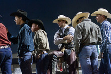Chris Detrick  |  The Salt Lake Tribune Cowboys watch the bull riding competition during the Dinosaur Roundup Rodeo Friday July 13, 2012. Tag Elliott was ranked 24th in the world when he was injured while attempting to ride a bull named Werewolf at the 2007 Days of '47 rodeo.