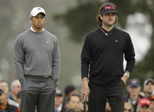 Bubba Watson and Tiger Woods wait to putt on the 10th green during the first round of the U.S. Open Championship golf tournament Thursday, June 14, 2012, at The Olympic Club in San Francisco. (AP Photo/Eric Risberg)