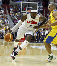 Team USA forward LeBron James works to get past team Brazil guard Alex Ribeiro Garcia during the first half of an Olympic exhibition basketball game Monday, July 16, 2012, in Washington. USA won 80-69. (AP Photo/Alex Brandon)