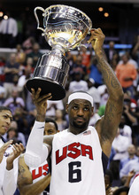 Team USA forward LeBron James holds the Global Community Cup after defeating Brazil 80-69 in an Olympic exhibition men's basketball game, Monday, July 16, 2012, in Washington. (AP Photo/Alex Brandon)