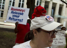 Marian Pickett, of Baton Rouge, La., protests outside a fundraiser for Republican presidential candidate, former Massachusetts Gov. Mitt Romney on Monday, July 16, 2012 in Baton Rouge, La.  (AP Photo/Evan Vucci)