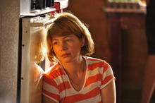 Michelle Williams is shown in a scene from