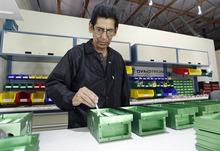 Al Hartmann  |  The Salt Lake Tribune Gerald Padilla, techincial supervisor at Dynotron works on assembling 96 LED