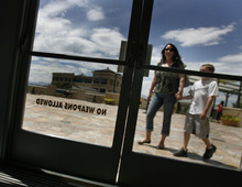 Scott Sommerdorf  |  The Salt Lake Tribune              Customers arrive at The Gateway Megaplex, Friday, July 20, 2012, near doors with a