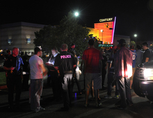 Police officers took witness statements outside a move theatre in Aurora, Colorado following an early morning shooting. Aurora Police responded to the Century 16 movie theatre early Friday morning, July 20, 2012.  Scanner traffic indicates that dozens of people were hurt in an incident inside the theatre. (AP Photo/Karl Gehring/The Denver Post)