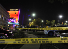 People gather outside the Century 16 movie theatre in Aurora, Colo., at the scene of a mass shooting early Friday morning, July 20, 2012.  Police Chief Dan Oates says 14 people are dead following the shooting at the suburban Denver movie theater. He says 50 others were injured when gunfire erupted early Friday at the Aurora theater.  Oates says a gunman appeared at the front of one of the Century 16 theaters. (AP Photo/The Denver Post, Karl Gehring)