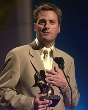 Michael W. Smith accepts his artist of the year award at the Dove Awards on Wednesday, March 24, 1999 in Nashville, Tenn. The Doves are given for achievement in gospel music. (AP Photo/Mark Humphrey)