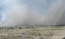 Cimaron Neugebauer | The Salt Lake Tribune  A dump fire in saratoga springs above a saratoga hills subdivision.