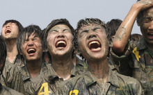 High school students shout during a summer military camp for students at the Cheongryong Self-denial Training Camp on Daebu Island in Ansan, South Korea, Friday, July 20, 2012. About 80 students took part in the three-day camp to strengthen their bodies and mind. (AP Photo/Ahn Young-joon)