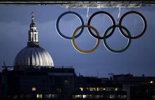 St. Paul's Cathedral is seen in the distance as the Olympic rings hang from the Tower Bridge, Thursday, July 19, 2012 in London. Opening ceremonies for the 2012 London Olympics will be held Friday, July 27. (AP Photo/Charlie Riedel)