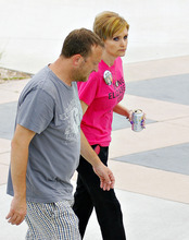 Drew and Heather Collins, of Evansdale, are seen at the RiverLoop Amphitheatre in Waterloo, Iowa following the 5K Run/Walk/Ride/Stroll/Roll for two missing Iowa cousins, Lyric Cook-Morrissey, 10, and Elizabeth Collins, 8, in Waterloo, Iowa on Saturday, July 21, 2012. Investigators reclassified the disappearance of two missing Iowa cousins as an abduction case Friday after an FBI dive team failed to find their bodies in a lake near where they were last seen a week ago. (AP Photo/Waterloo Courier, Dawn J. Sagert)
