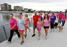 Participants in the 5K Run/Walk/Ride/Stroll/Roll for two missing Iowa cousins, Lyric Cook-Morrissey, 10, and Elizabeth Collins, 8, in Waterloo, Iowa on Saturday, July 21, 2012. Investigators reclassified the disappearance of two missing Iowa cousins as an abduction case Friday after an FBI dive team failed to find their bodies in a lake near where they were last seen a week ago. (AP Photo/Waterloo Courier, Dawn J. Sagert)